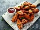 Рецепта Печени пилешки крилца, мариновани в бира, червено вино, кетчуп, горчица, мед и майонеза на фурна
